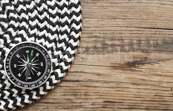 marine roll ropes and compass on wooden background Stock photo © inxti