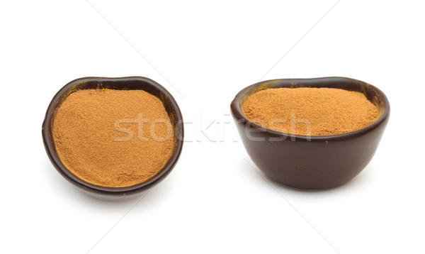 Grounded cinnamon in a clay bowl Stock photo © inxti