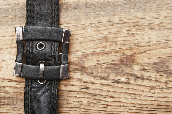 vintage belt buckle on a old wooden board  Stock photo © inxti