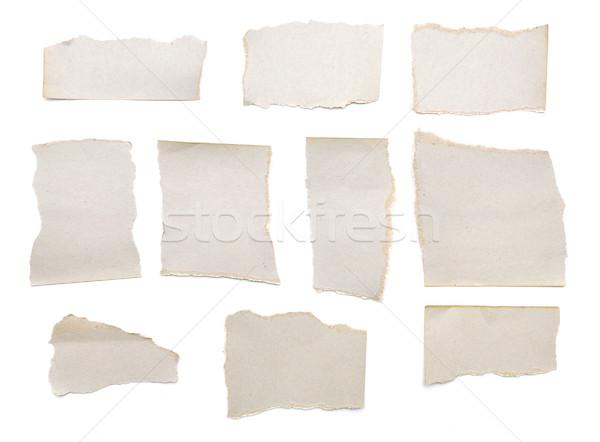 Gyűjtemény szürke darabok papír fehér egy Stock fotó © inxti