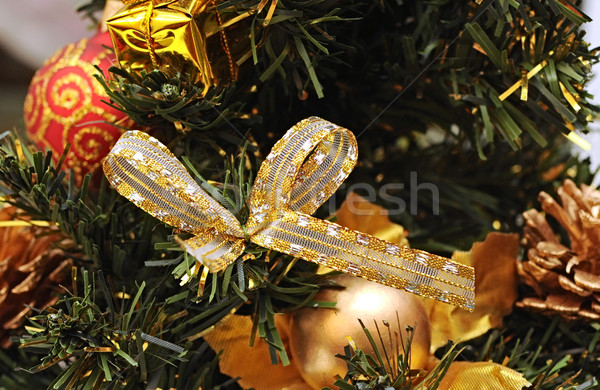 satin ribbon bow hanging on a green spruce branch  Stock photo © inxti