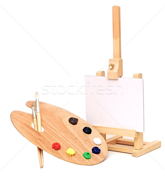 Photo of an artists easel with a blank canvas plus palette of pa Stock photo © inxti