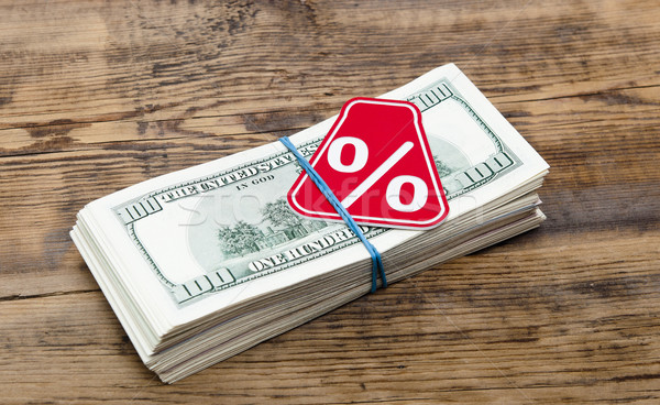 Sign % on the background of one hundred dollar bills  Stock photo © inxti