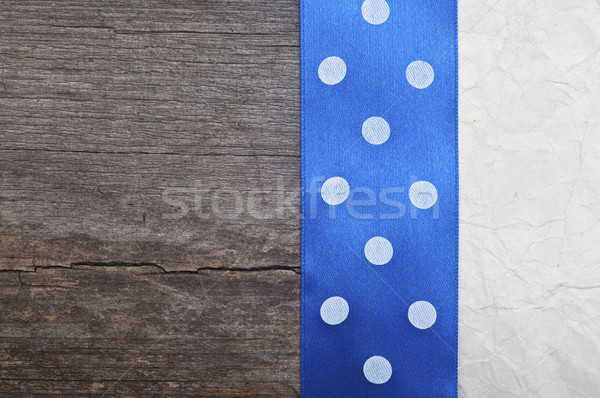 wooden background with blue polka-dot ribbon on crumpled paper  Stock photo © inxti