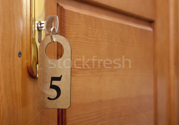 key in keyhole with numbered label  Stock photo © inxti