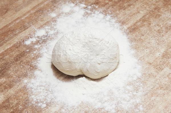 Sprinkle flour on dough Stock photo © inxti