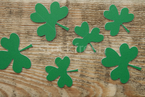 Green clovers or shamrocks on rustic wood background Stock photo © inxti