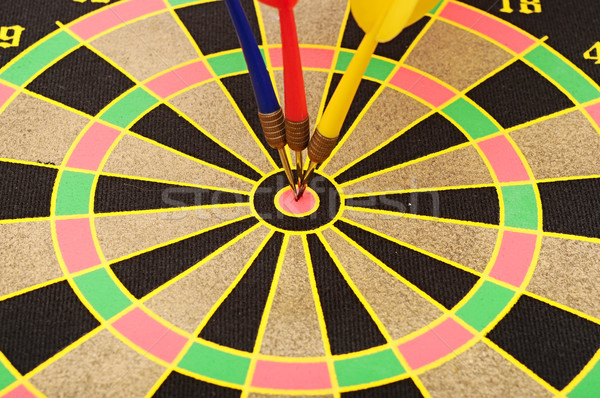 Cut image of dart pierced on target over dartboard  Stock photo © inxti