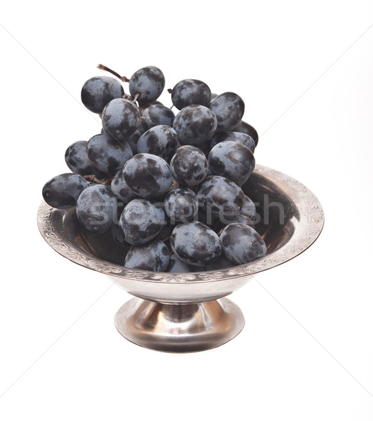 Branch of black grape in metal bowl isolated on white background Stock photo © inxti