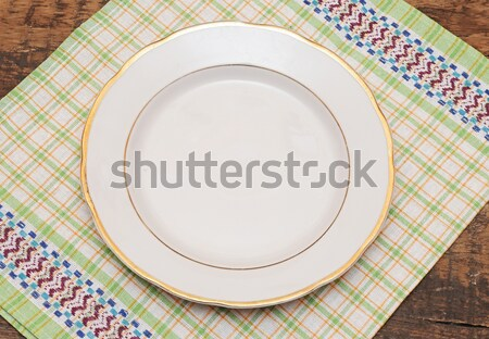 white plate on blue checked fabric tablecloth  Stock photo © inxti