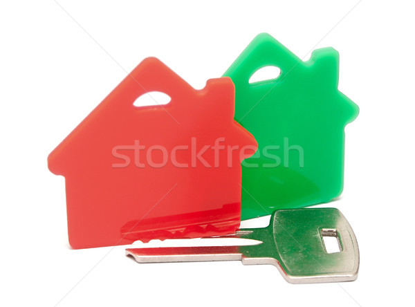 Stock photo: red with green houses and key, on a white background