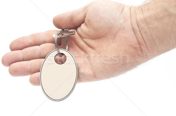 Sleutel label menselijke hand ring witte contract Stockfoto © inxti