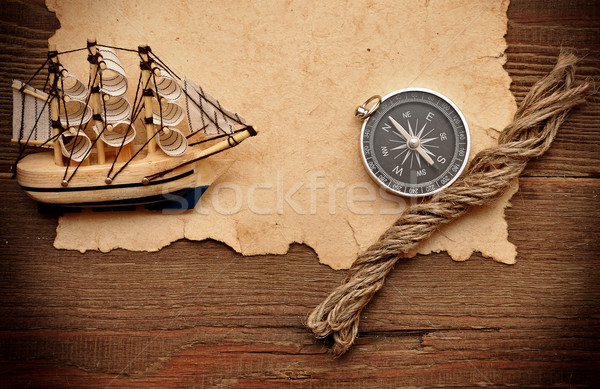 old paper, compass, rope and model classic boat on wood backgrou Stock photo © inxti