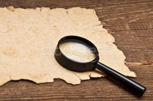 magnifying glass on old paper Stock photo © inxti