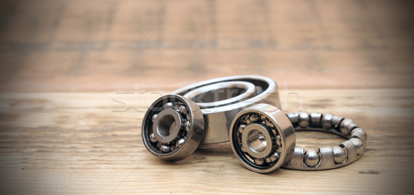 steel ball bearings on wooden table. space for your text Stock photo © inxti