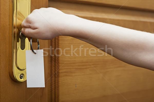 Children hand are unlocked door  Stock photo © inxti