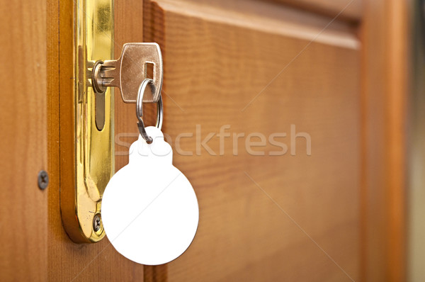 key in keyhole with blank label shape Christmas ball Stock photo © inxti