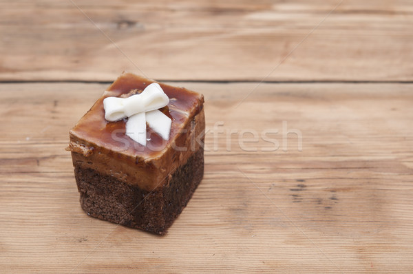 Chocolate muffin with white ribbon on wooden background  Stock photo © inxti
