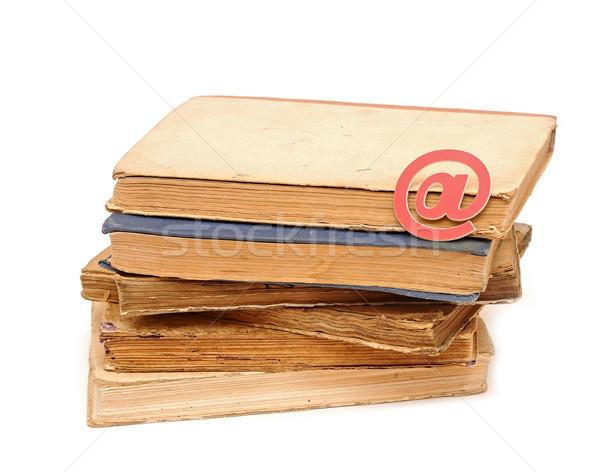 e-mail icon on pile books Stock photo © inxti