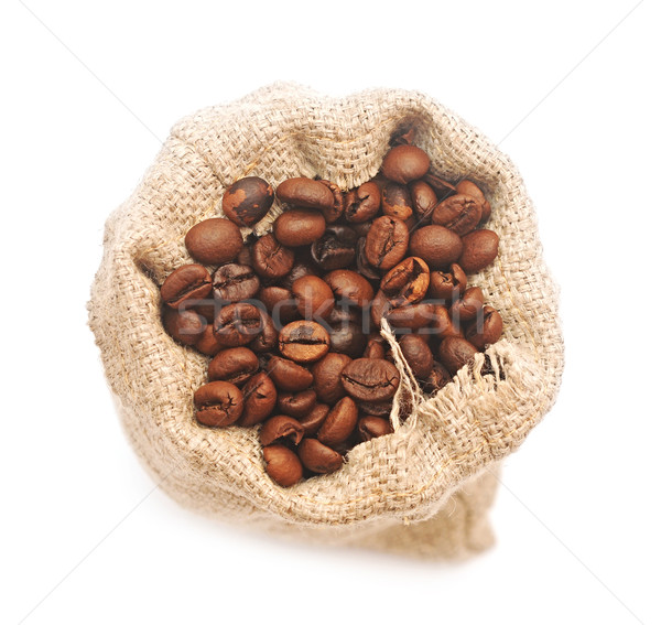 Top view of roasted coffee beans in jute bag Stock photo © inxti