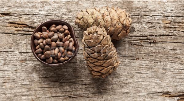 Pine cones on wood Stock photo © inxti