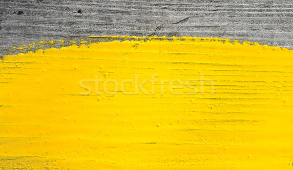 yellow paint on old wooden background Stock photo © inxti
