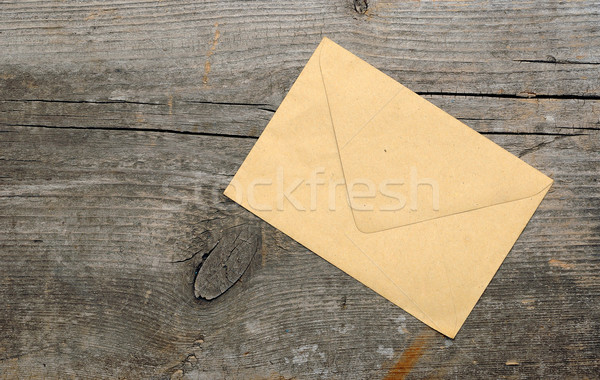Old envelope on wooden background . With copy space Stock photo © inxti
