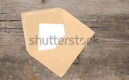 Blank paper and envelope on old wooden background  Stock photo © inxti