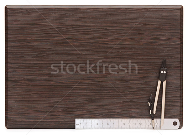 Metal measuring devices on wooden plate including ruler and comp Stock photo © inxti
