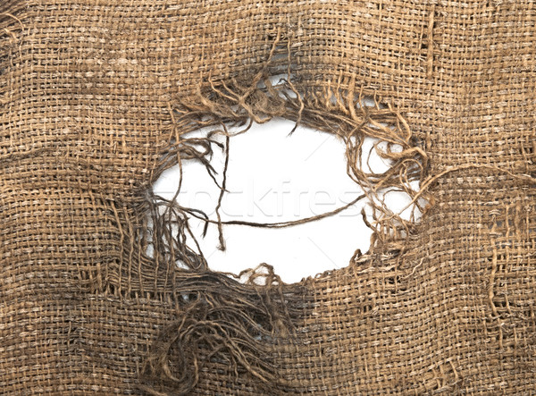 Torn burlap decayed. Ragged linen fabric.  Stock photo © inxti