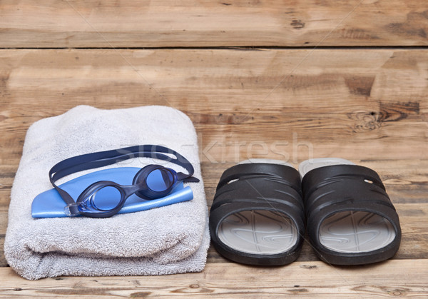 glasses for swimming and towel on wooden background Stock photo © inxti