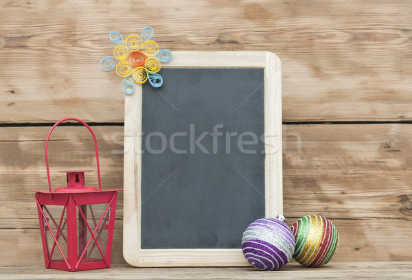 Christmas decoration with framed blackboard on wooden background Stock photo © inxti
