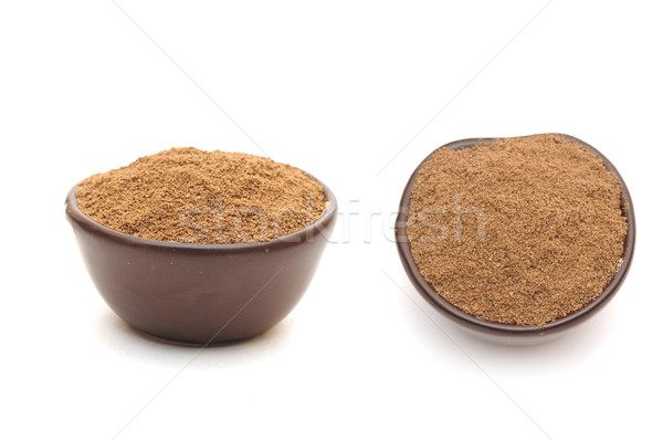 ground nutmeg in a clay bowl Stock photo © inxti