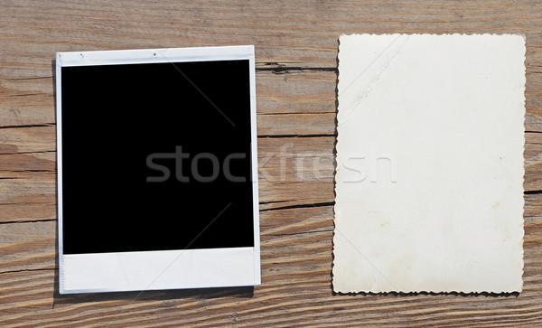 old photos on wooden background  Stock photo © inxti