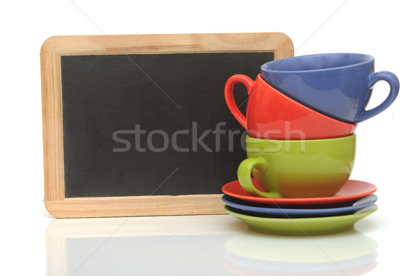 Set of colorful cups with blackboard on white. tea time Stock photo © inxti
