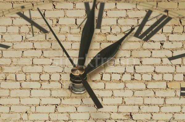 Retro clock on brick wall  Stock photo © inxti
