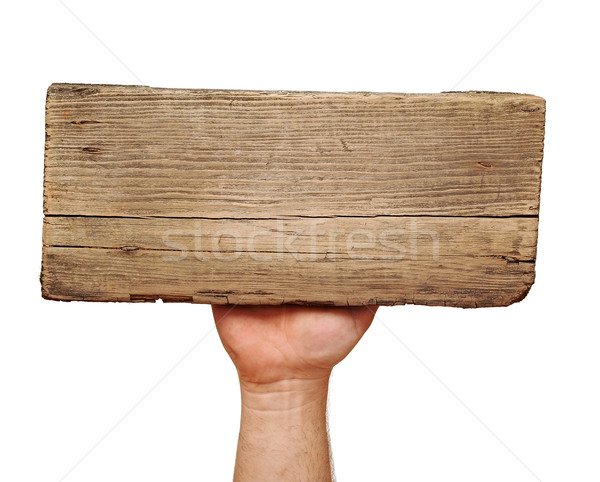 Wooden board sign on hand isolate on white  Stock photo © inxti