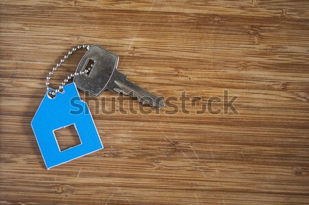 key with plastic card on wooden background Stock photo © inxti
