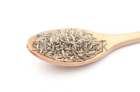 cumin seeds in wooden spoon  Stock photo © inxti