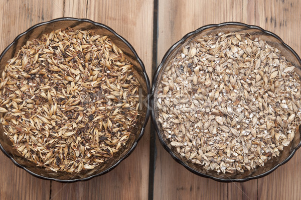 Two glasss bowl with beer ingredients barley malt Stock photo © inxti