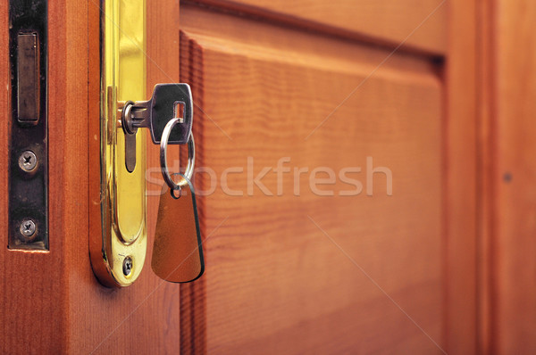 key in keyhole with blank label  Stock photo © inxti