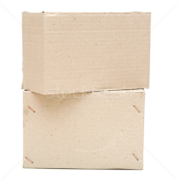 Brown cardboard boxes arranged in stack on white background Stock photo © inxti