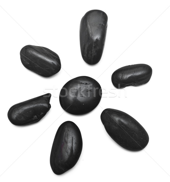 some black stones forming a flower on a white background Stock photo © inxti