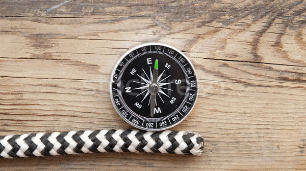 marine rope and compass on wooden background Stock photo © inxti