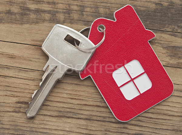 A key in a lock with house icon on it  Stock photo © inxti