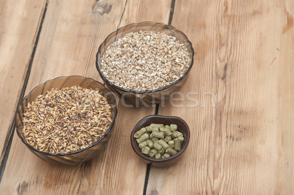 beer ingredients, hops and malt on wooden table top Stock photo © inxti