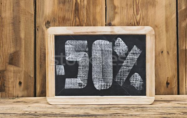 пятьдесят процент скидка написанный доске школы Сток-фото © inxti