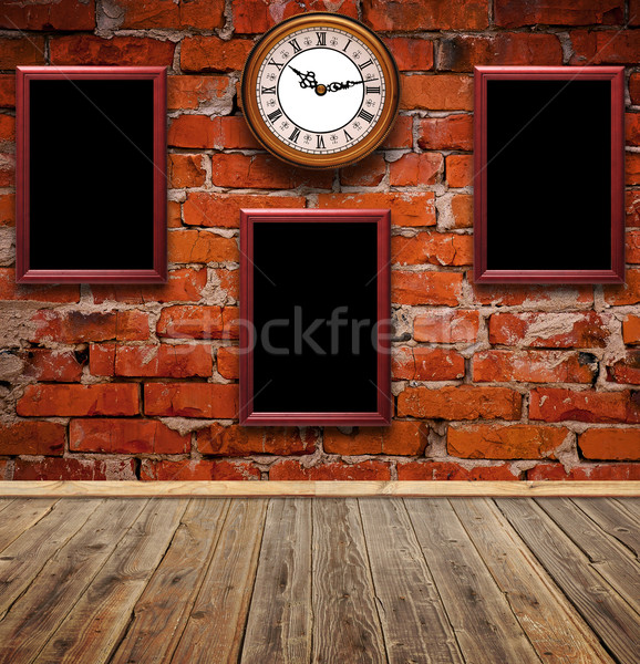 empty photo frames and watch against an brick wall in old room  Stock photo © inxti