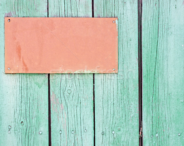 Wooden signboard hanging on planks background  Stock photo © inxti