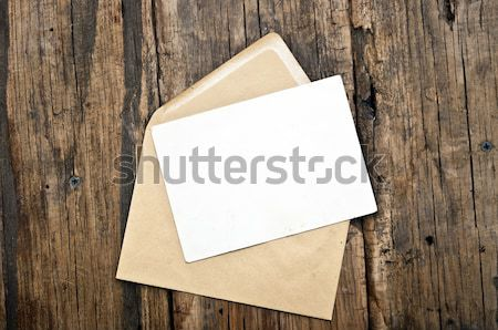 Blank postcard and envelope on old wooden background  Stock photo © inxti